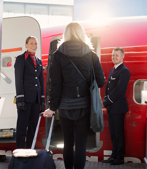 Woman boarding a Norwegian plane
